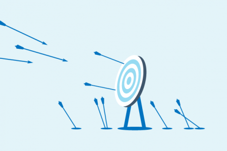 a target with arrows flying towards it